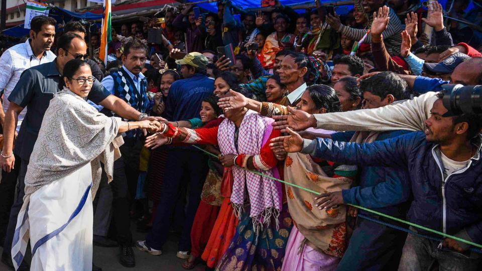 West Bengal Chief Minister Mamata Banerjee meets local people during a protest rally against the amended Citizenship Act and NRC, in Purulia district.
