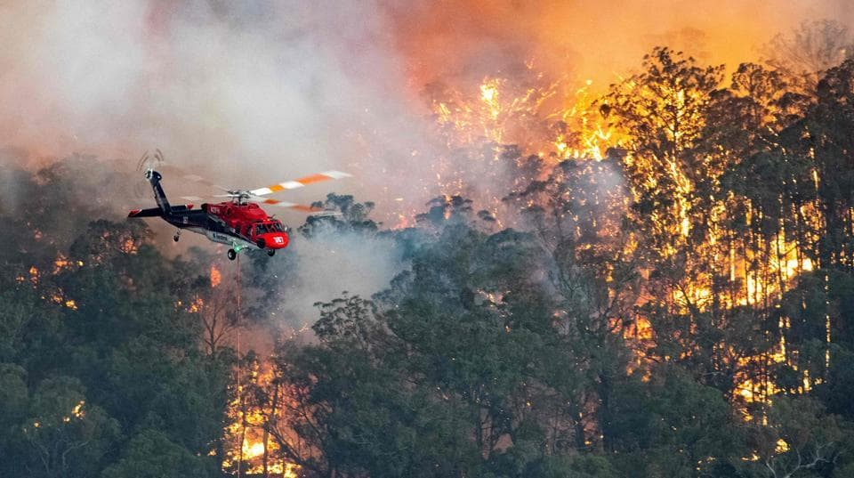Photos: Thousands of people trapped as fires encircle ...