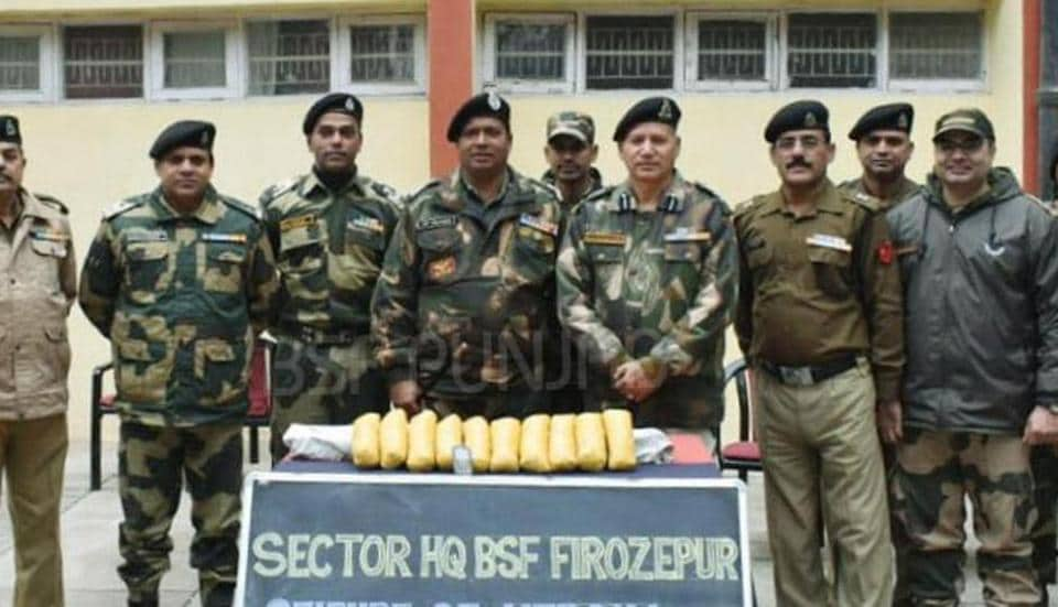 BSF officials with the seized heroin at Indo-Pak border in Ferozepur on Monday.