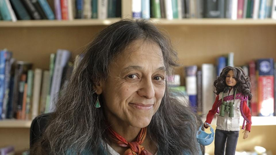 Ecologist Nalini Nadkarni is shown in her lab on the University of Utah campus in Salt Lake City holding a Barbie created to look like her when she's climbing into the treetops to study the rainforest canopy.