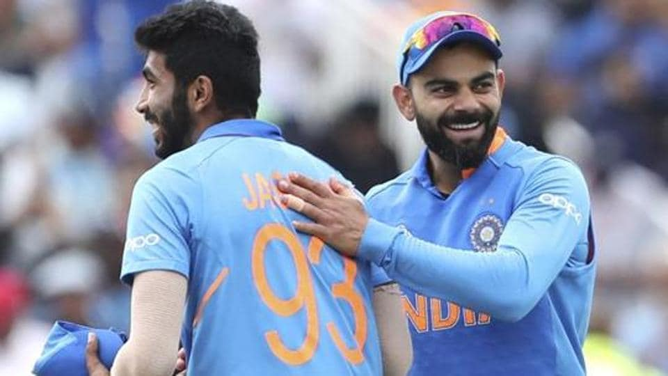 India's captain Virat Kohli, right, celebrates with teammate Jasprit Bumrah