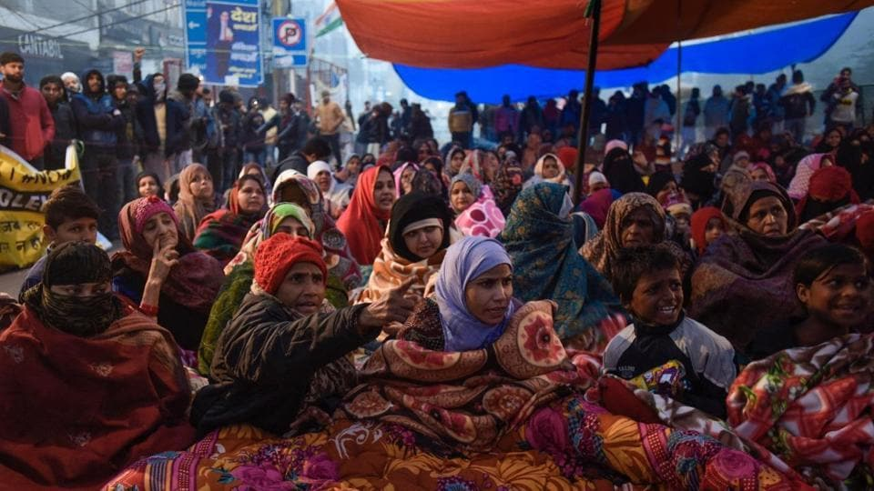 Women protesters along with their children participate in an indefinite sit-in against Citizenship Amendment Act, at Shaheen Bagh in New Delhi.