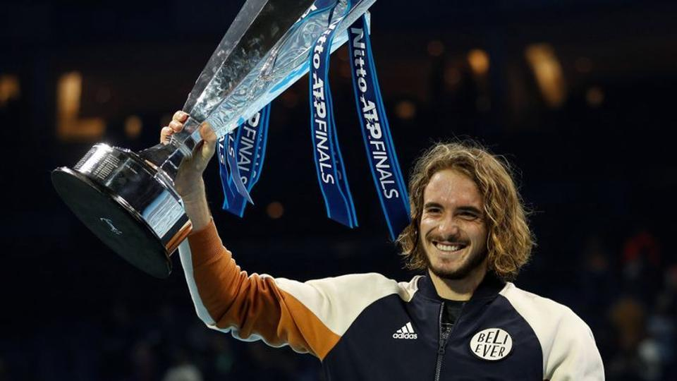 Greece's Stefanos Tsitsipas celebrates winning the ATP Finals with the trophy.