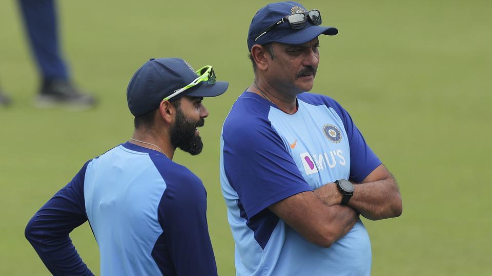 Indian cricket captain Virat Kohli, left, speaks with coach Ravi Shastri