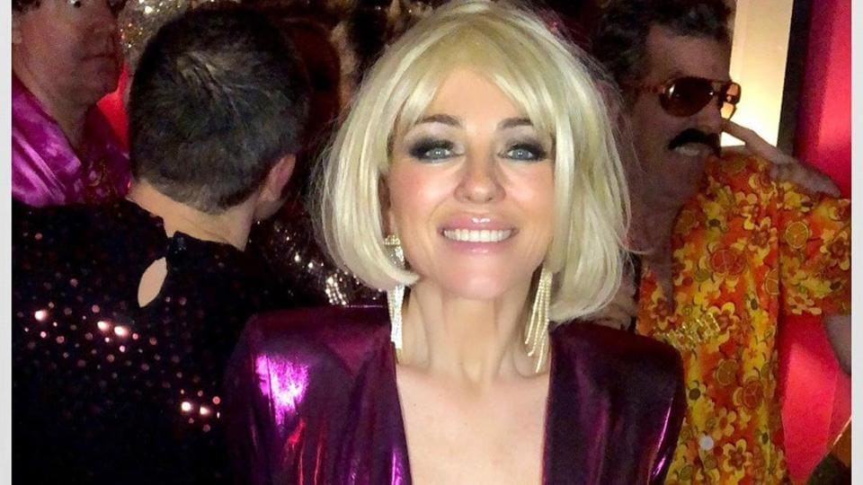 Elizabeth Hurley's age-defying New Year party pic in purple, plunging neckline dress and blonde wig...