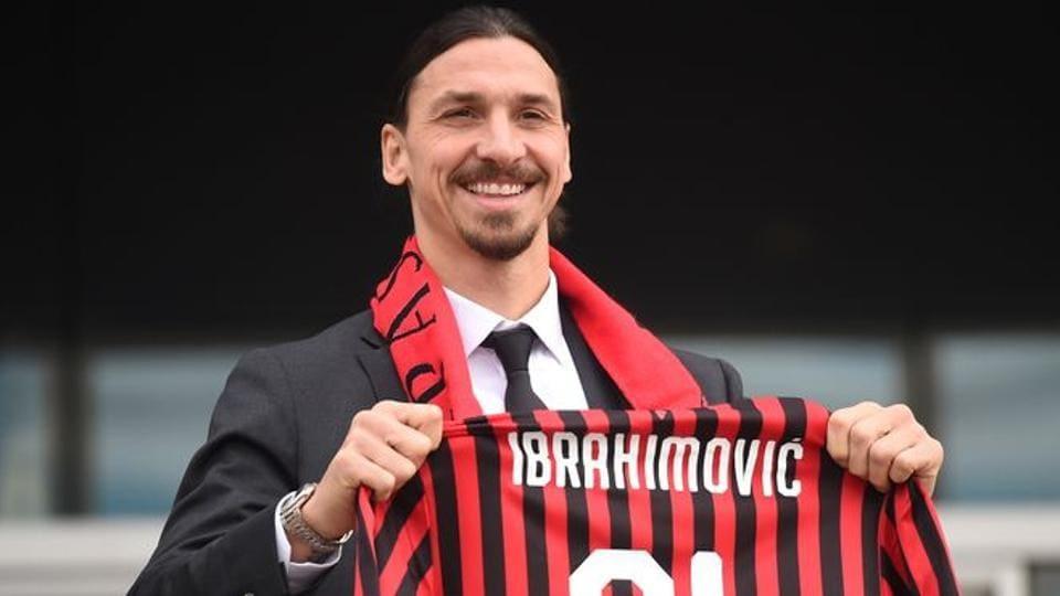 Zlatan Ibrahimovic holds up his AC Milan shirt after signing for AC Milan.