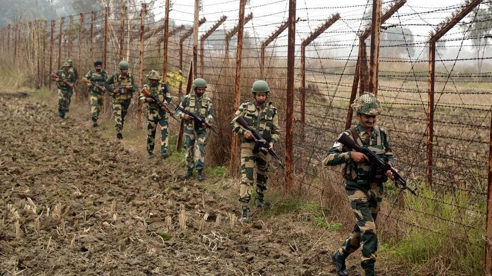 Jammu and Kashmir, Dec 24 (ANI): Border Security Force soldiers patrol near the INDO-PAK International border on Cold morning at Arnia Sector in Jammu on Tuesday. (ANI Photo)