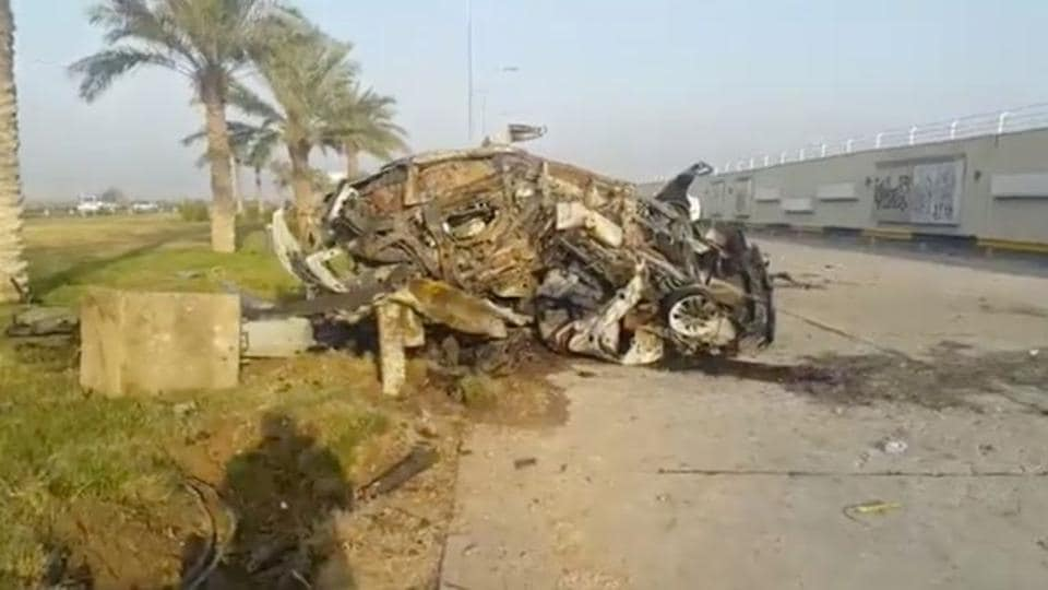 A damaged car, claimed to belong to Qassem Soleimani and Abu Mahdi al Muhandis, is seen near Baghdad International Airport, Iraq January 3, 2020 in this still image taken from video.
