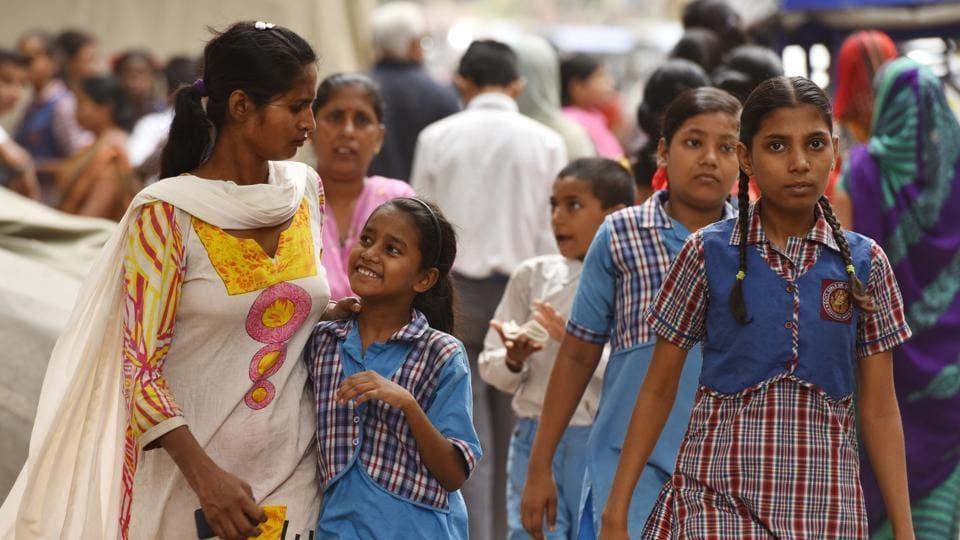 Students and parents leave after attending a mega Parent Teacher Meet)