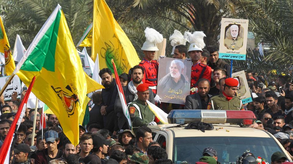 Mourners surround a car carrying the coffin of Iranian military commander Qassem Soleimani, Baghdad, January 4