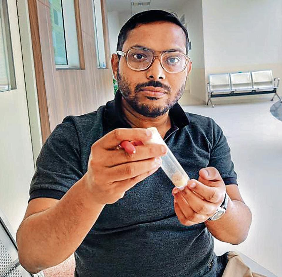 IISER scientist Sutirth Dey with a vial of tiny common fruitfly Drosophila