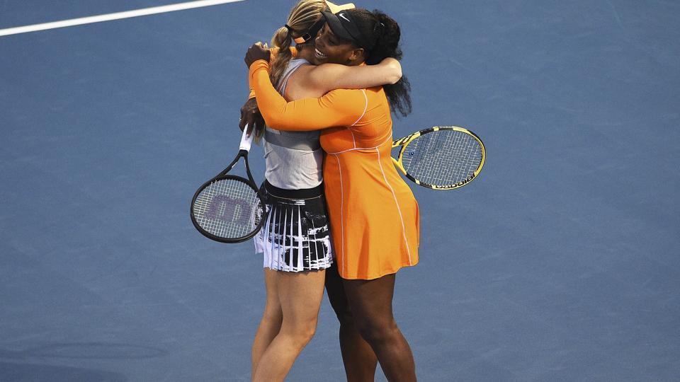 Denmark's Caroline Wozniacki, left, and Untied States' Serena Williams celebrate their win.