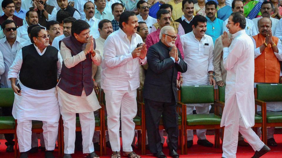 Maharashtra Chief Minister Uddhav Thakeray greets his cabinet Ministers as he arrives for a group photograph at the premise of Vidhan Bhawan, in Nagpur.