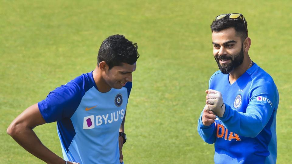 Indian skipper Virat Kohli with teammate Navdeep Saini