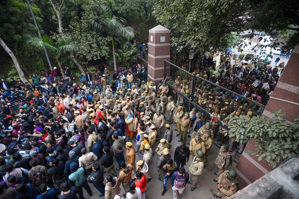 Students stage a protest at main Gate of JNU over Sunday's violence.