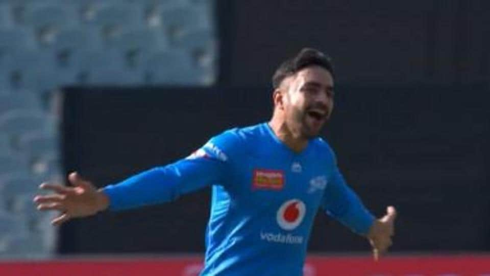 Rashid Khan celebrates after picking up a hat-trick against Sydney Sixers.