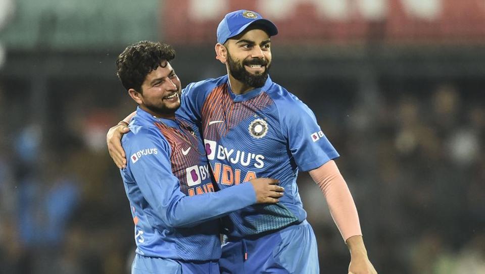 Indian bowler Kuldeep Yadav celebrates the wicket of Sri Lankan batsman Kusal Perera with Virat Kohli
