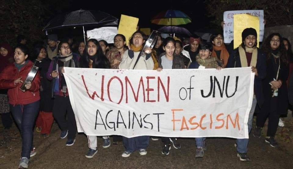 People hold placards during a protest march in solidarity with JNU students against Sunday's violence, at JNU campus, in New Delhi, India, on Tuesday, January 7, 2020.