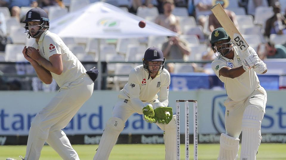 South African Vernon Philander plays a shot while England's wicketkeeper Jos Buttler, center, looks on