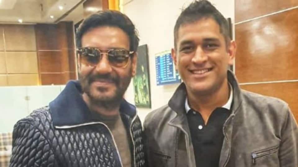 MS Dhoni poses for a photo with Ajay Devgn.