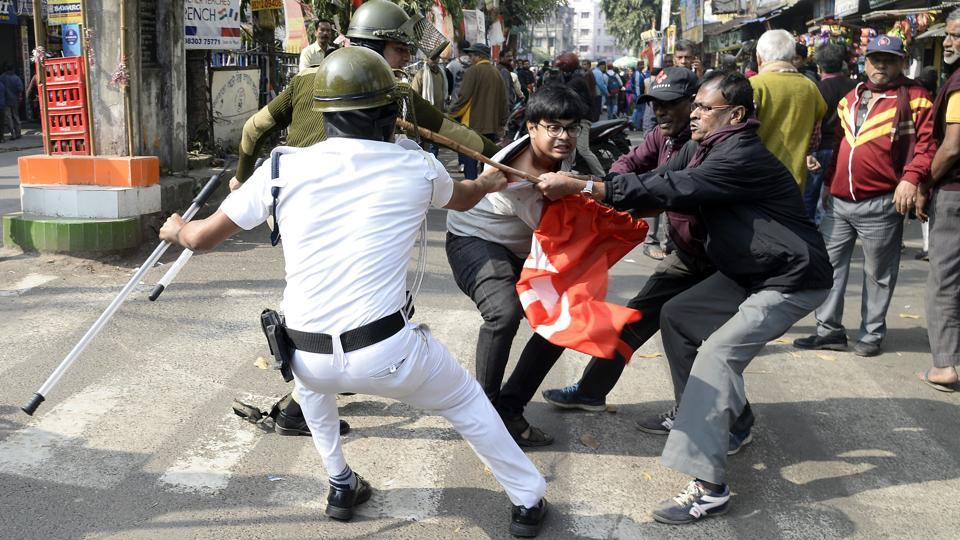 Left Front party activists clash with police personnel during a nationwide strike called by trade unions in Kolkata on Wednesday.
