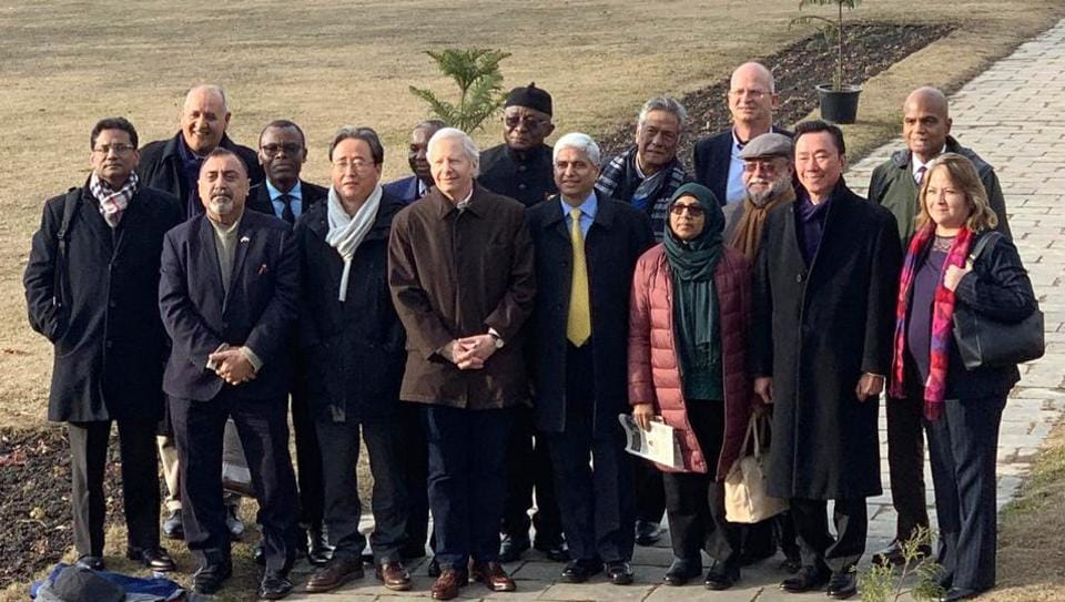 15 Foreign envoy poses for a photograph on the banks of Dal Lake during their visit to Srinagar on Thursday