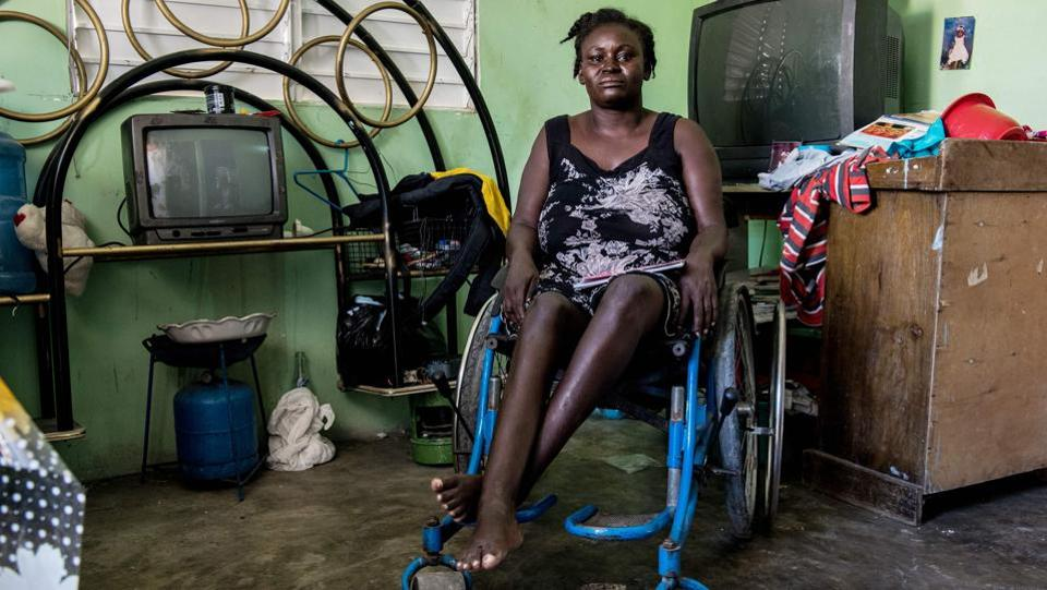 Herlande Mitile, 36, at home in Village Lumane Casimir, northeast of Port-au-Prince. Ten years ago, Mitile was left disabled by the 7.0 magnitude earthquake that devastated Haiti. Today, she uses a wheelchair jury-rigged with a piece of string, which means she cannot go far. She is confined to her village, which itself was meant to be a model for reconstruction of the country after the disaster. (Chandan Khanna/AFP)