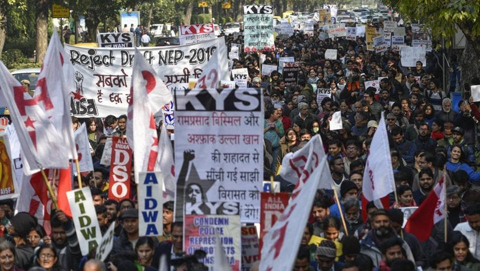 Students from Jawaharlal Nehru University (JNU) hold placards and raise slogans during a protest march from Mandi House to HRD Ministry, demanding the removal of their vice-chancellor, in New Delhi on Thursday.