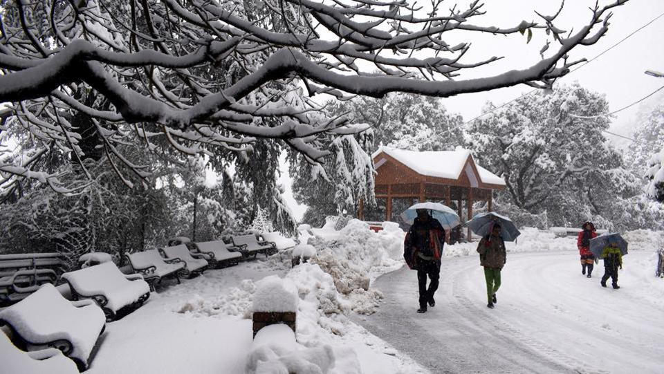 The higher reaches and middle hills in the state have experienced heavy snowfall with Khadrala experiencing the highest at 56 cm of snow. Meanwhile, low-lying areas were lashed with incessant rains, Paonta Sahib in Sirmour district recording the heaviest at 40.8 mm. (Deepak Sansta/HT Photo)