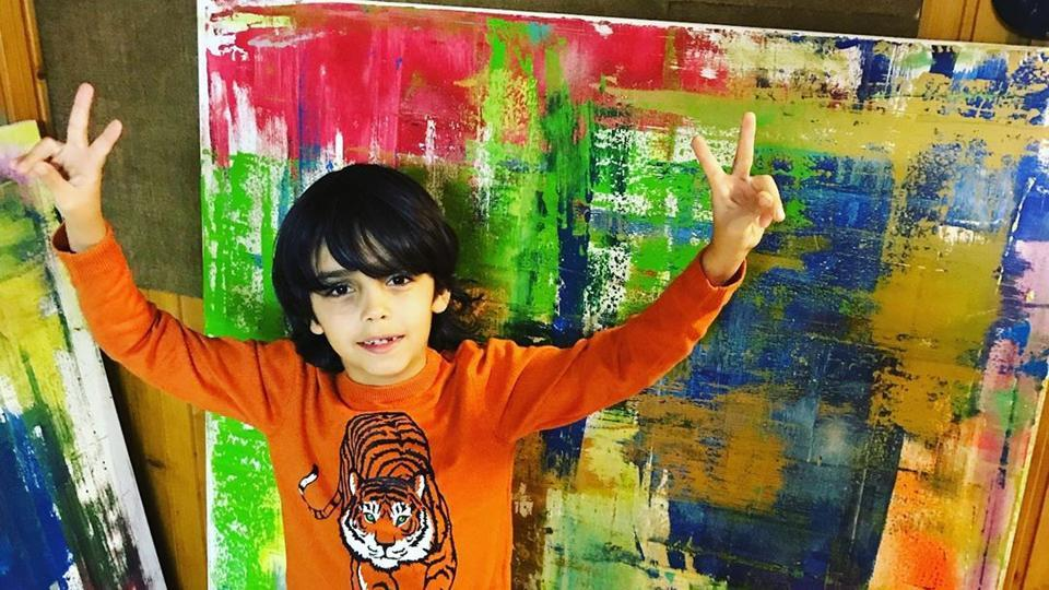 'Pre-school Picasso', Mikail Akar, with his artwork.
