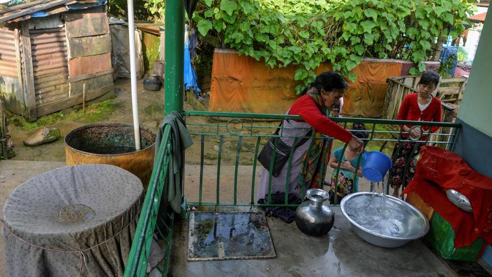 Tyllod Khongwir fills a container from a storage of rain water collected at her home at Nongthymmai-Lumthangding village on the outskirts of Shillong, Meghalaya. Every drop of rain water trickling down Khongwir's rusty tin roof and into her house is collected. Meghalaya, home to two of the wettest places on earth, is among the greenest states in India but it has rapidly lost its rich rainforests over the last few decades. (Diptendu Dutta / AFP)