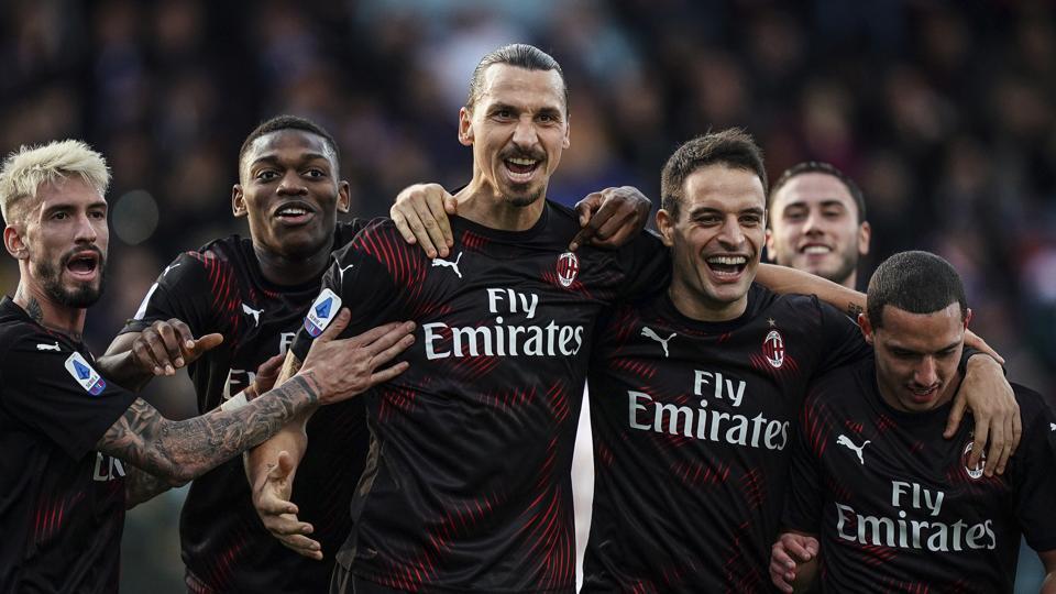 Milan's Zlatan Ibrahimovic celebrates with teammates.