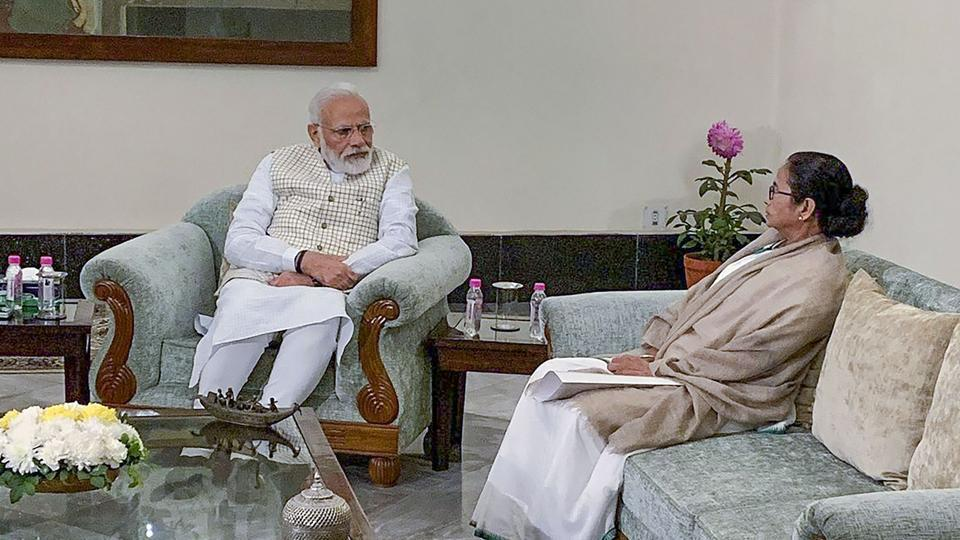 Prime Minister Narendra Modi with West Bengal CM Mamata Banerjee during a meeting in Kolkata on Saturday