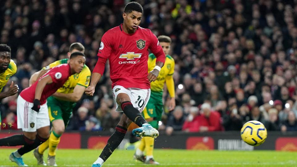 Manchester United's Marcus Rashford scores their second goal from the penalty spot.