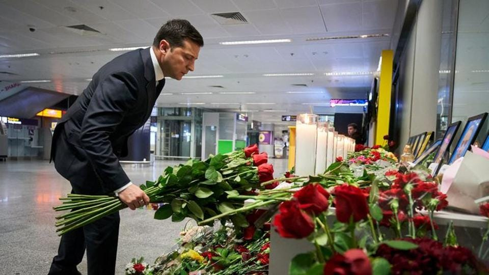 Ukrainian President Volodymyr Zelenskiy lays flowers to commemorate victims of the Ukraine International Airlines Boeing 737-800 plane crash, at a memorial in Boryspil International airport outside Kiev.