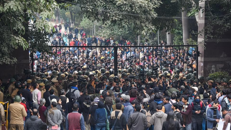 Students protesting at main Gate of JNU over Sunday's violence, in New Delhi on Monday.