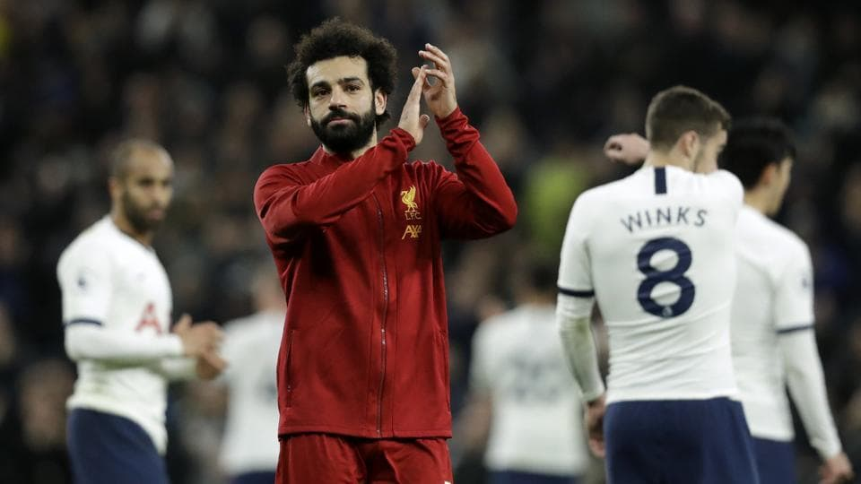 Liverpool's Mohamed Salah applauds at the end of the English Premier League soccer match between Tottenham Hotspur and Liverpool at the Tottenham Hotspur Stadium in London
