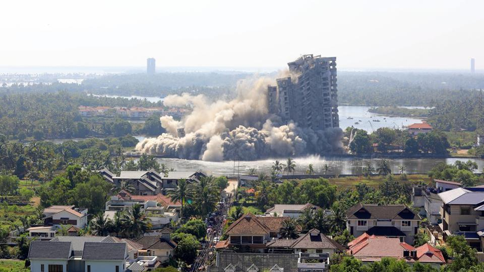 Jain Coral Cove apartment built in violation of Coastal Regulation Zone norms in Maradu Municipality, being demolished through a controlled implosion, in Kochi. Four illegal multi-storey apartment complexes in Maradu town of Kerala's Kochi were successfully demolished in two rounds of controlled implosion. (Vivek R Nair/HTPhoto)