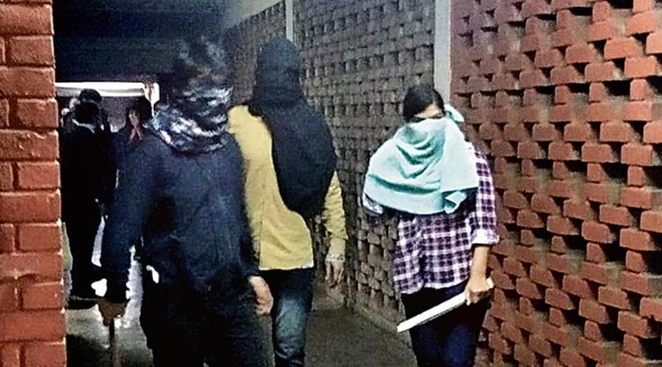 Police said they have identified the masked woman (right) involved in the attack as a student of Daulat Ram College.