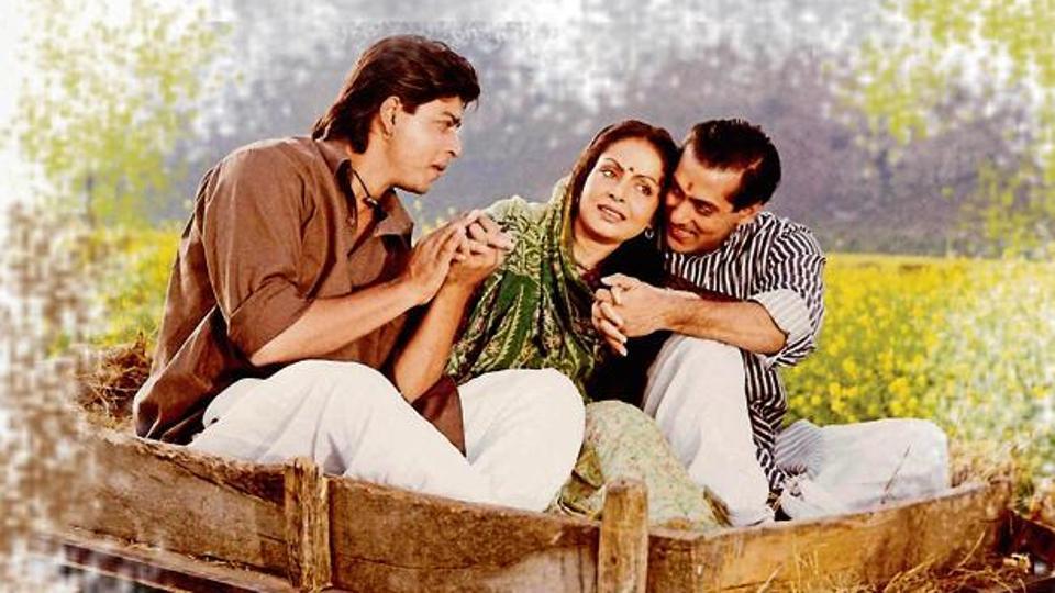 Shah Rukh Khan and Salman Khan with Rakhee in a still from Karan Arjun.