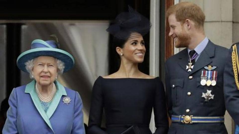 Britain's Queen Elizabeth II, and Meghan the Duchess of Sussex and Prince Harry