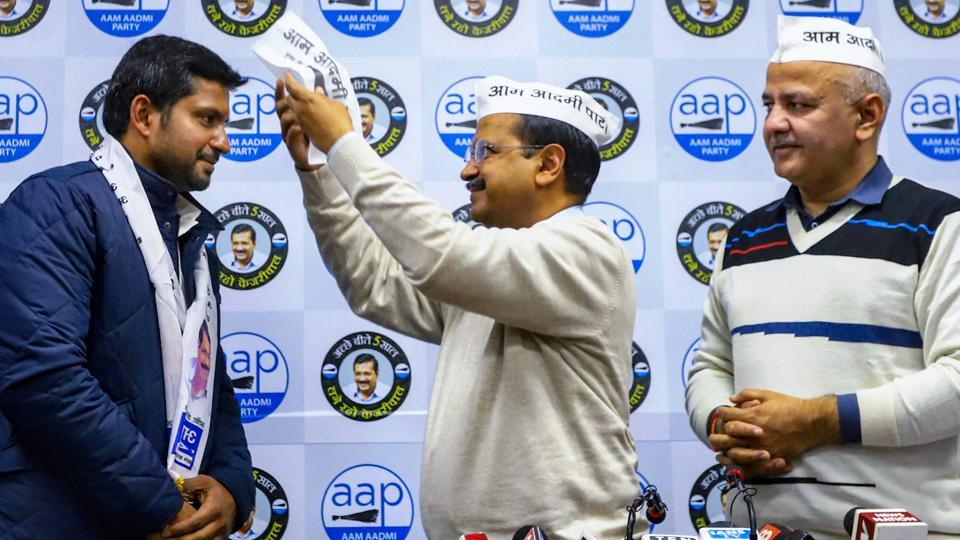 Delhi CM Arvind Kejriwal welcomes Vinay Mishra, son of former Congress Parliamentarian Mahabal Mishra after the former joined AAP party in the presence of Deputy CM Manish Sisodia and others, in New Delhi, Monday.