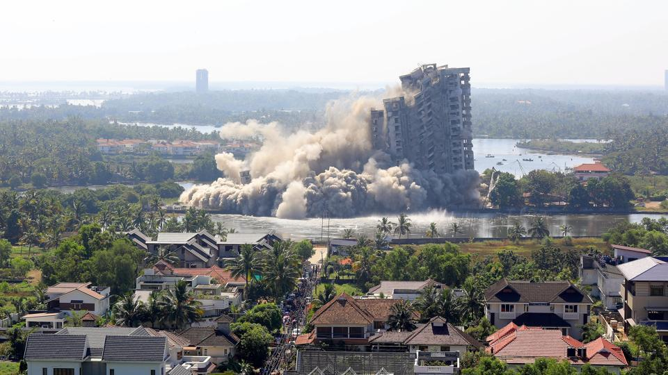 A view of Jain Coral Cove apartment built in violation of Coastal Regulation Zone norms in Maradu Municipality, being demolished through a controlled implosion in Kochi on Sunday.
