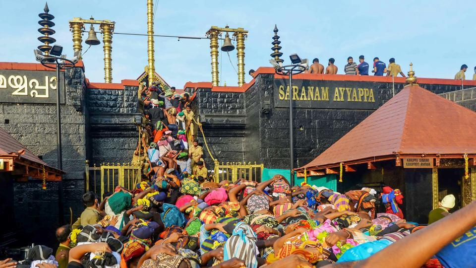 Devotees throng the Lord Ayyappa temple to offer prayers, at Sabarimala in Kerala on December 31, 2019.