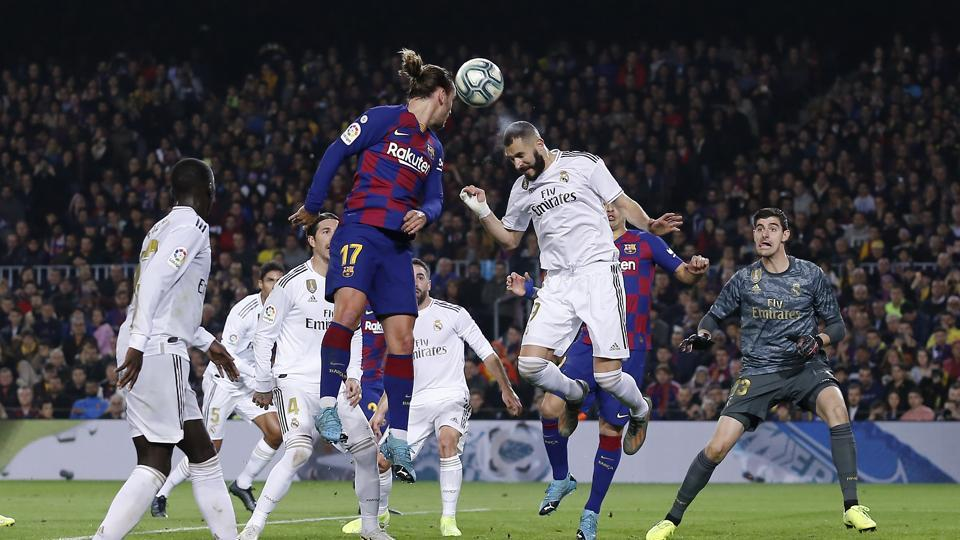 Players of Real Madrid and Barcelona in action.