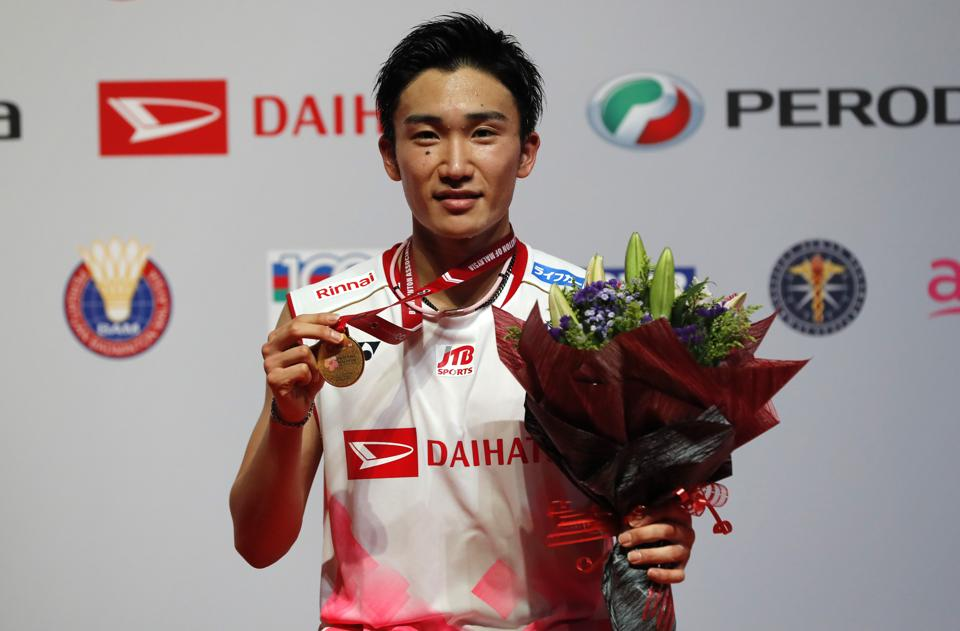 Kento Momota poses with his medal after defeating Denmark's Viktor Axelsen during men single final of the Malaysia Masters.
