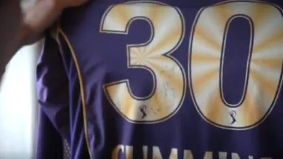 Pat Cummins shows off the old KKR jersey gifted to him by a fan.