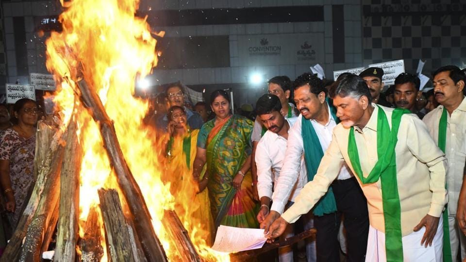 Telugu Desam Party chief NChandrababu Naidu and Joint Action Committee leaders of Amravati farmers burn copies of the expert committee's reports on shifting the capital of Andhra Pradesh to Visakhapatnam.