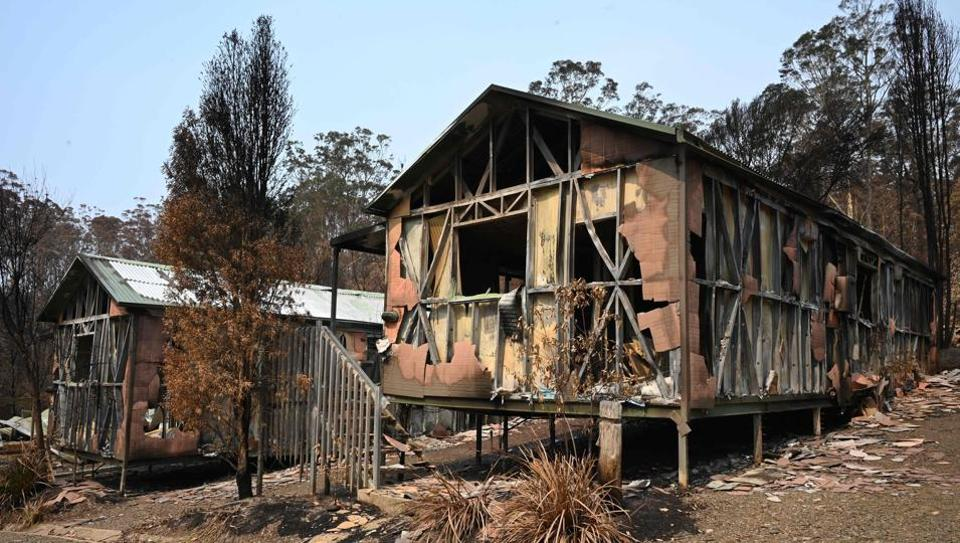 Accommodation blocks at the Gold Rush Colony in Mogo, a tourist attraction dedicated to Mogo's 1850s gold rush -- where a recent bushfire reduced it to twisted metal and ash. The unprecedented scale of Australia's bushfires have tainted the country's reputation as a safe and alluring holiday destination.  (Holly Robertson / AFP)
