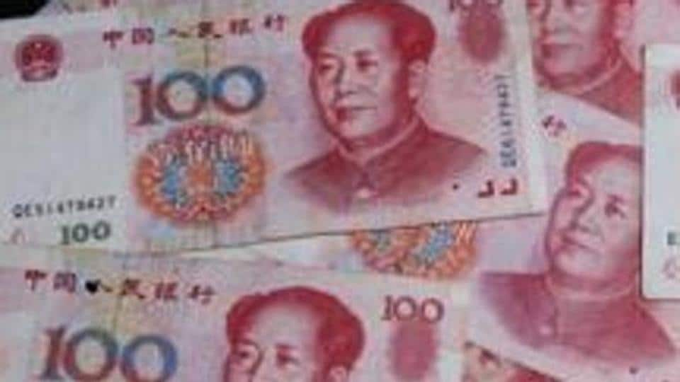 Chinese yuan notes and US dollar bills are photographed on Thursday, November 30, 2006, in New York.